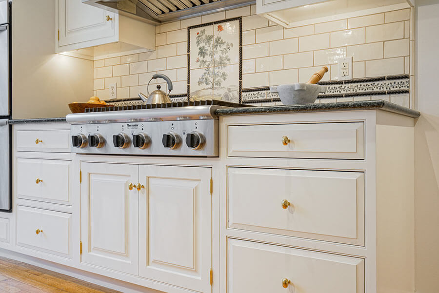 We make your kitchen look brand new with our kitchen cabinet refinishing services at John Neill Painting & Decorating.